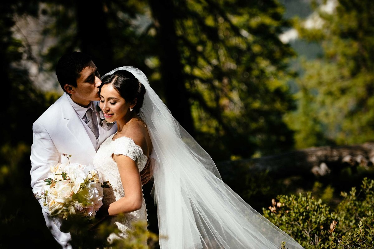 groom kissing bride during their WEDDING AT YOSEMITE NATIONAL PARK