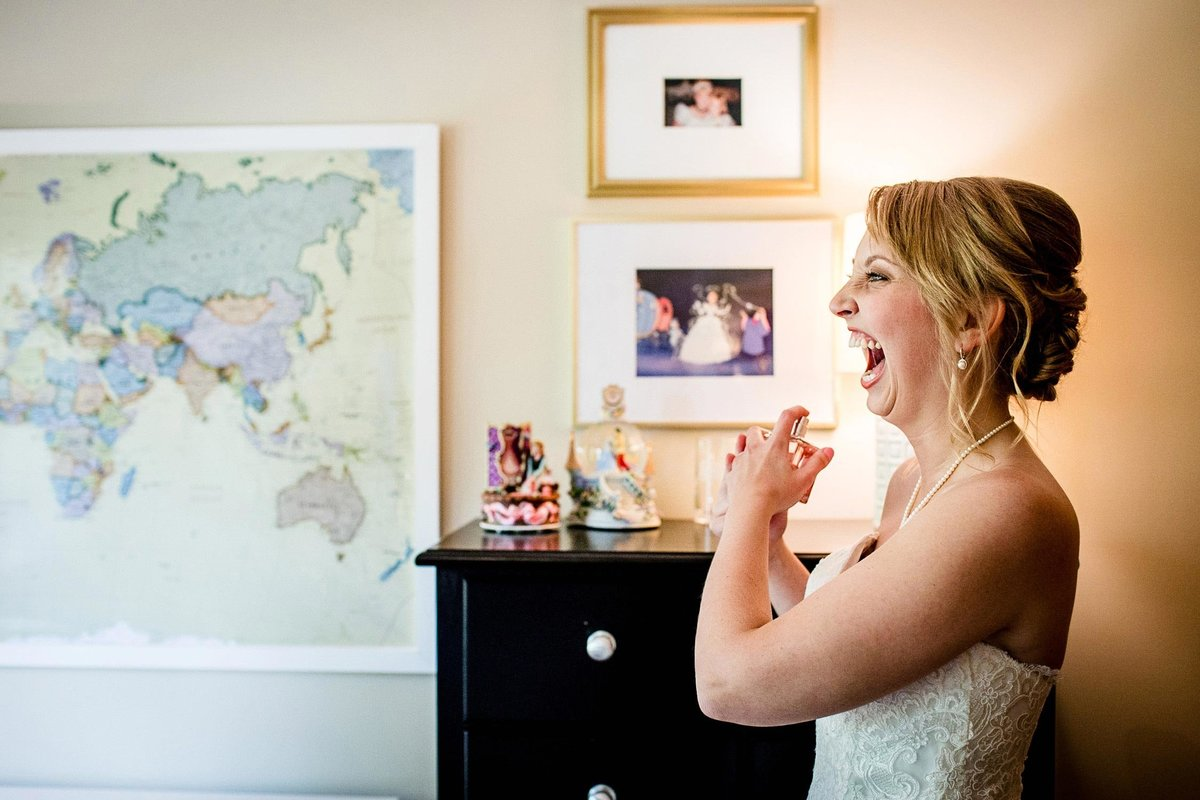 A bride laughs while getting ready before her Chicago wedding ceremony.