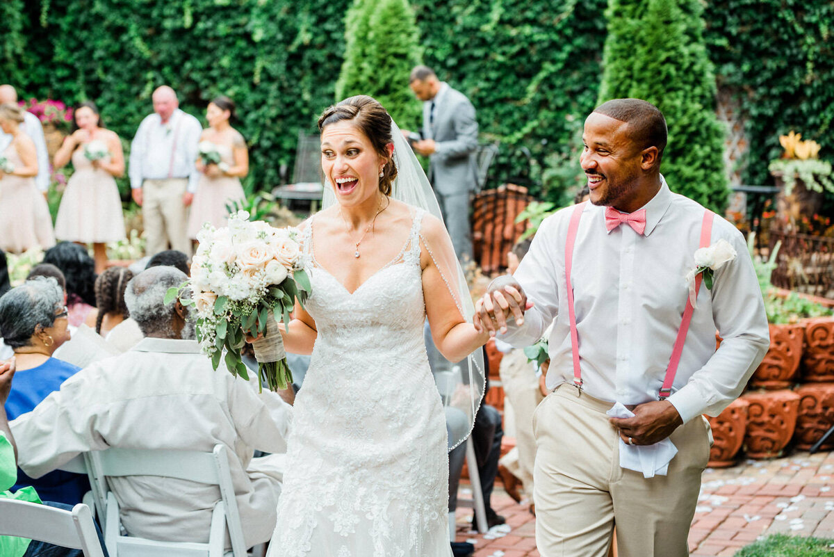 bride and groom joyful recessional in old market