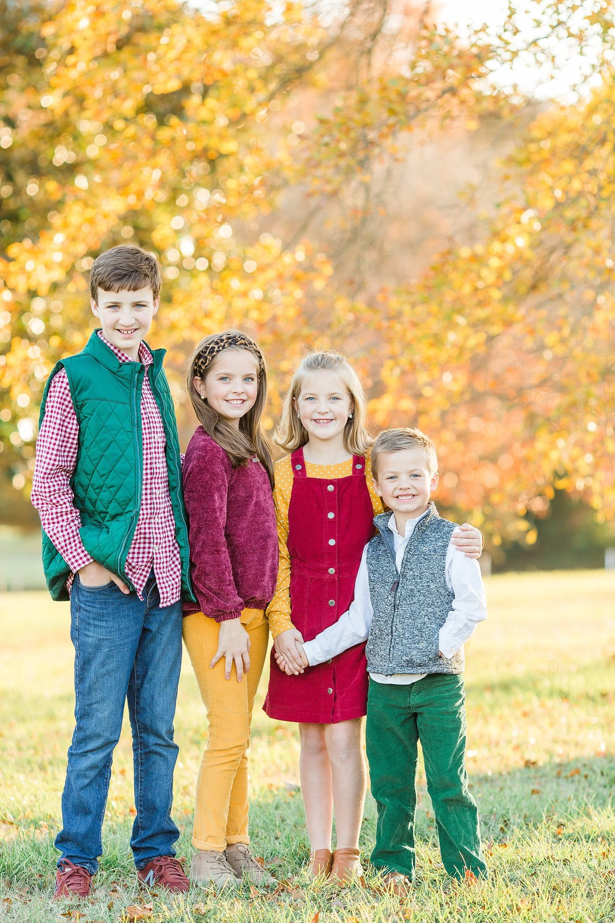 siblings-maroon-mustard-green-fall-golden-light-leaves