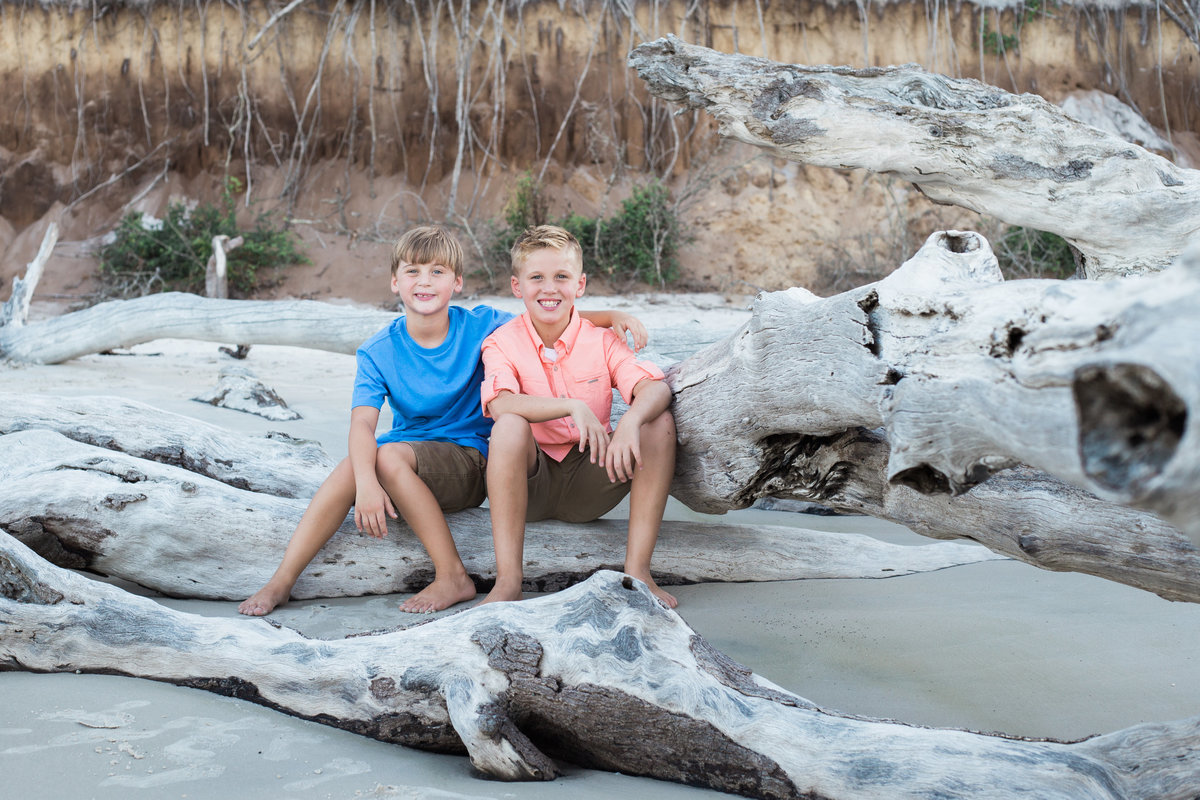 Portrait of two bother with arms wrapped around eachother taken by Jacksonville Family Photographer at Big Talbot Island