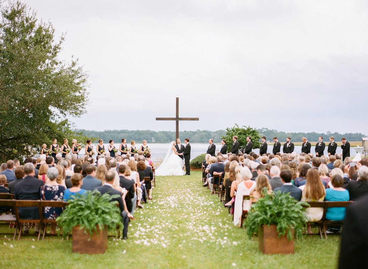 Charleston Wedding Ceremony with Mahogany Cross Waterfront Views Bride and Groom at Altar