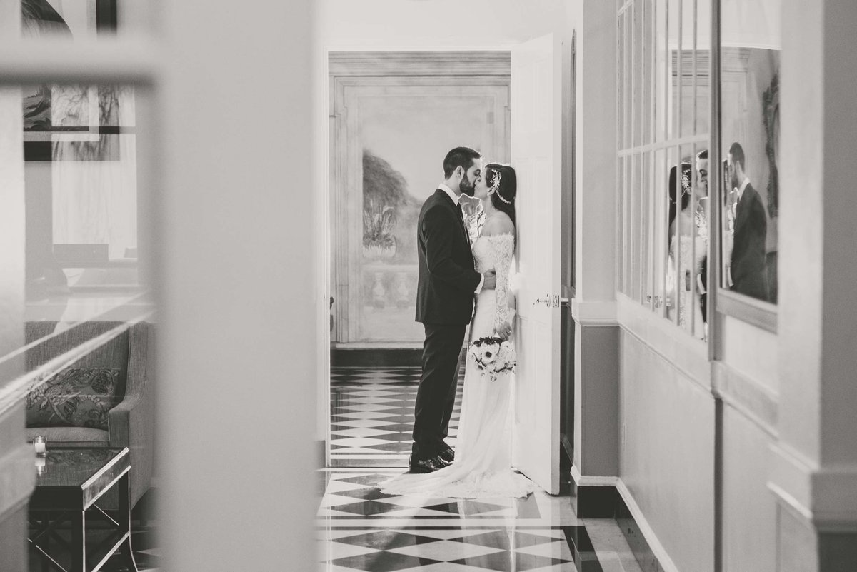 Bride and groom leaning on the wall at The Mansion at Oyster Bay