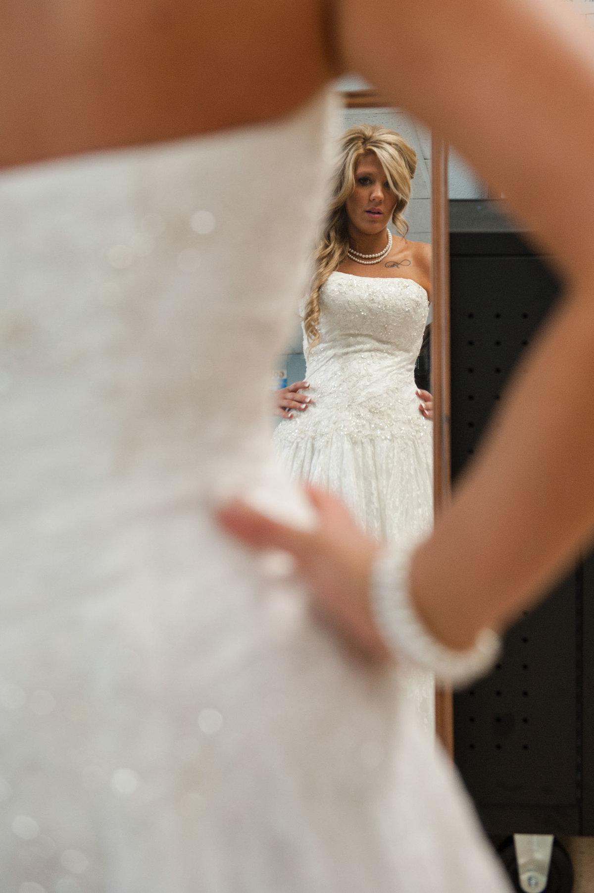 picture of bride looking in mirror