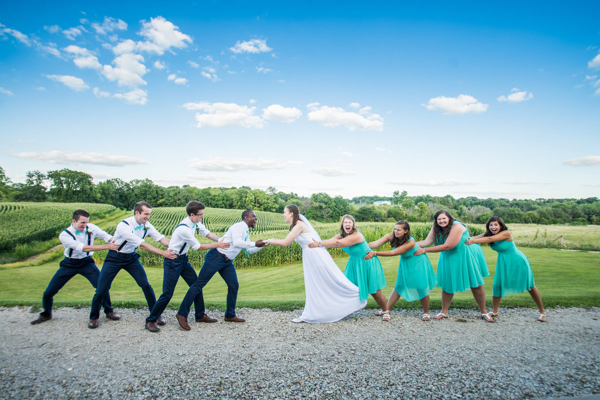bright dynamic sky wedding party picture at A Prarie Lodge