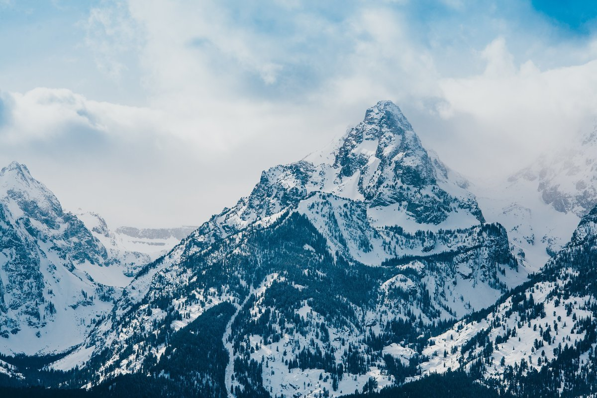 Snow covers the Grand Teton National Park mountains in the winter
