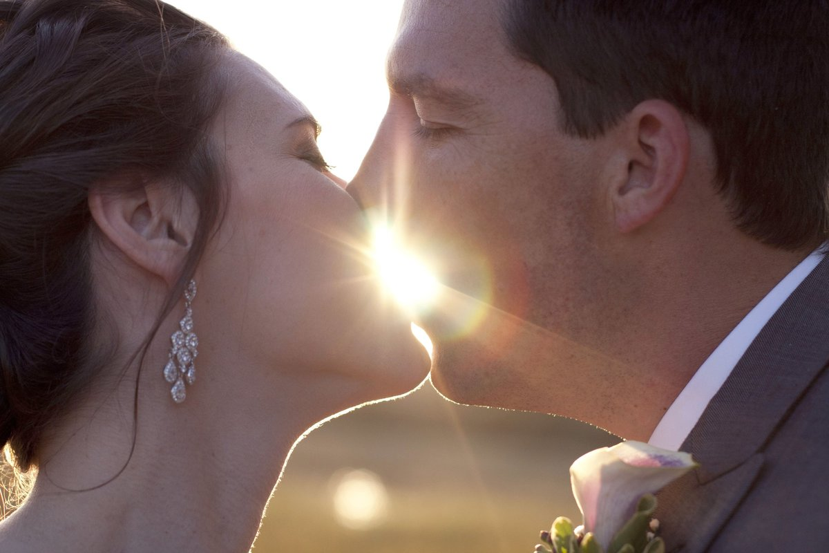 sunburst kiss of bride and groom