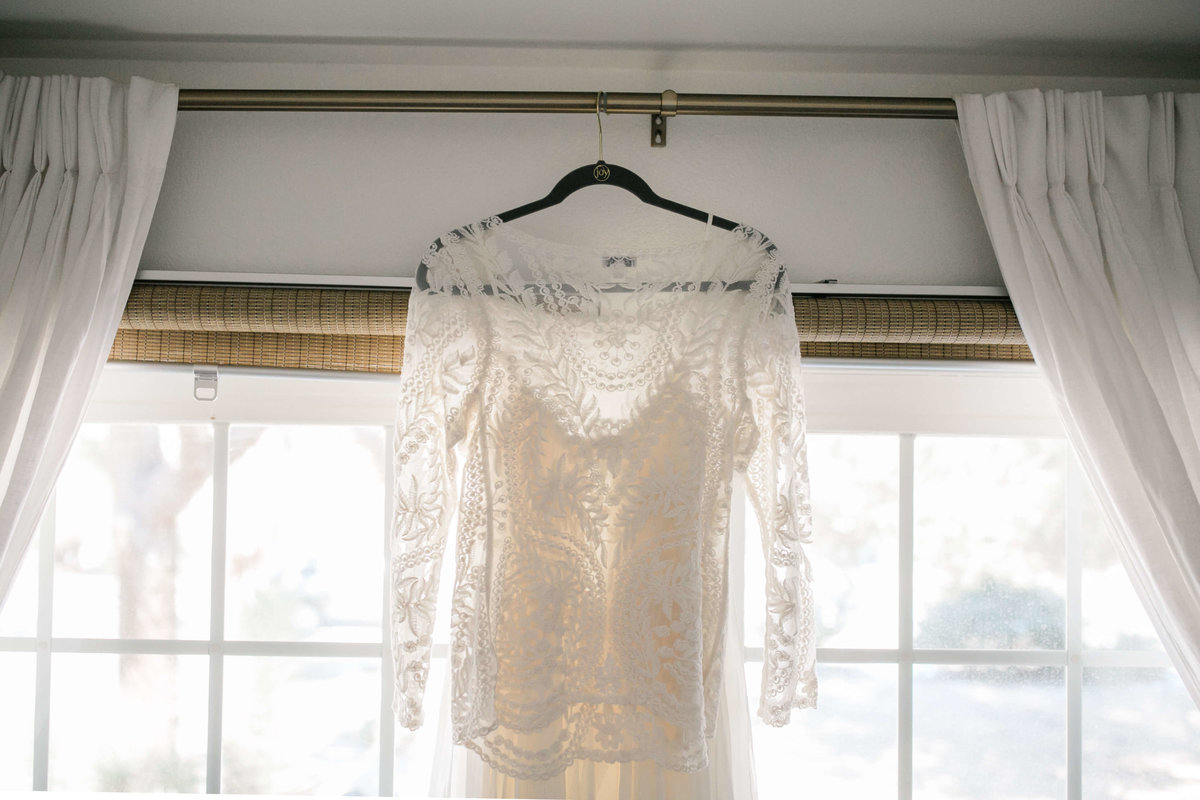 the bridal top hangs on the window