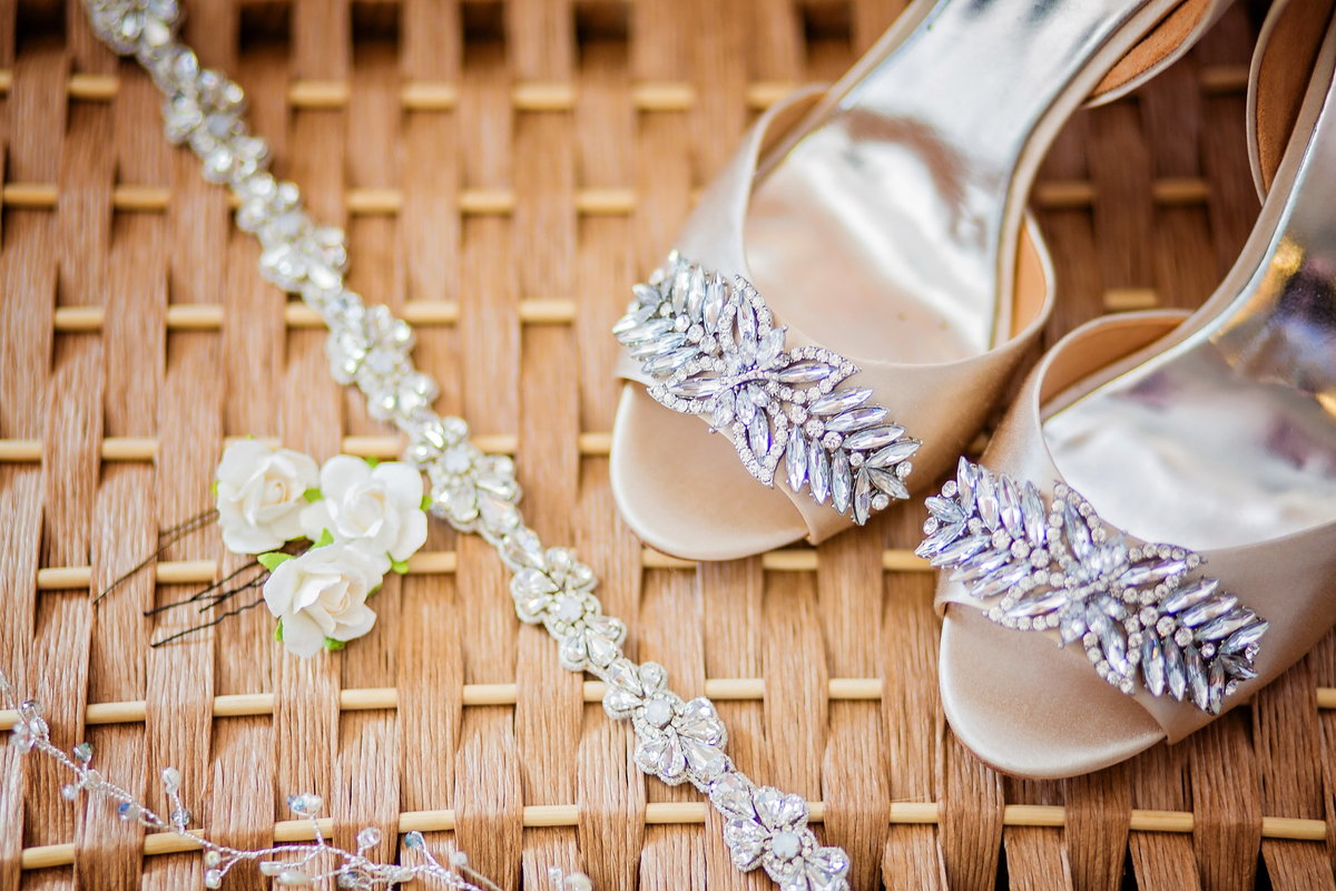 Badgley Mischka jewel wedding shoes, beaded gem bridal belt and floral hair accessories, together on a basket, Charleston, SC