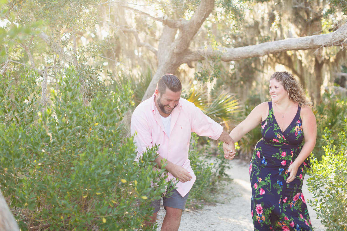 Couple on a Nature Trail During their Omni Plantation Engagement Photo Session in Amelia Island