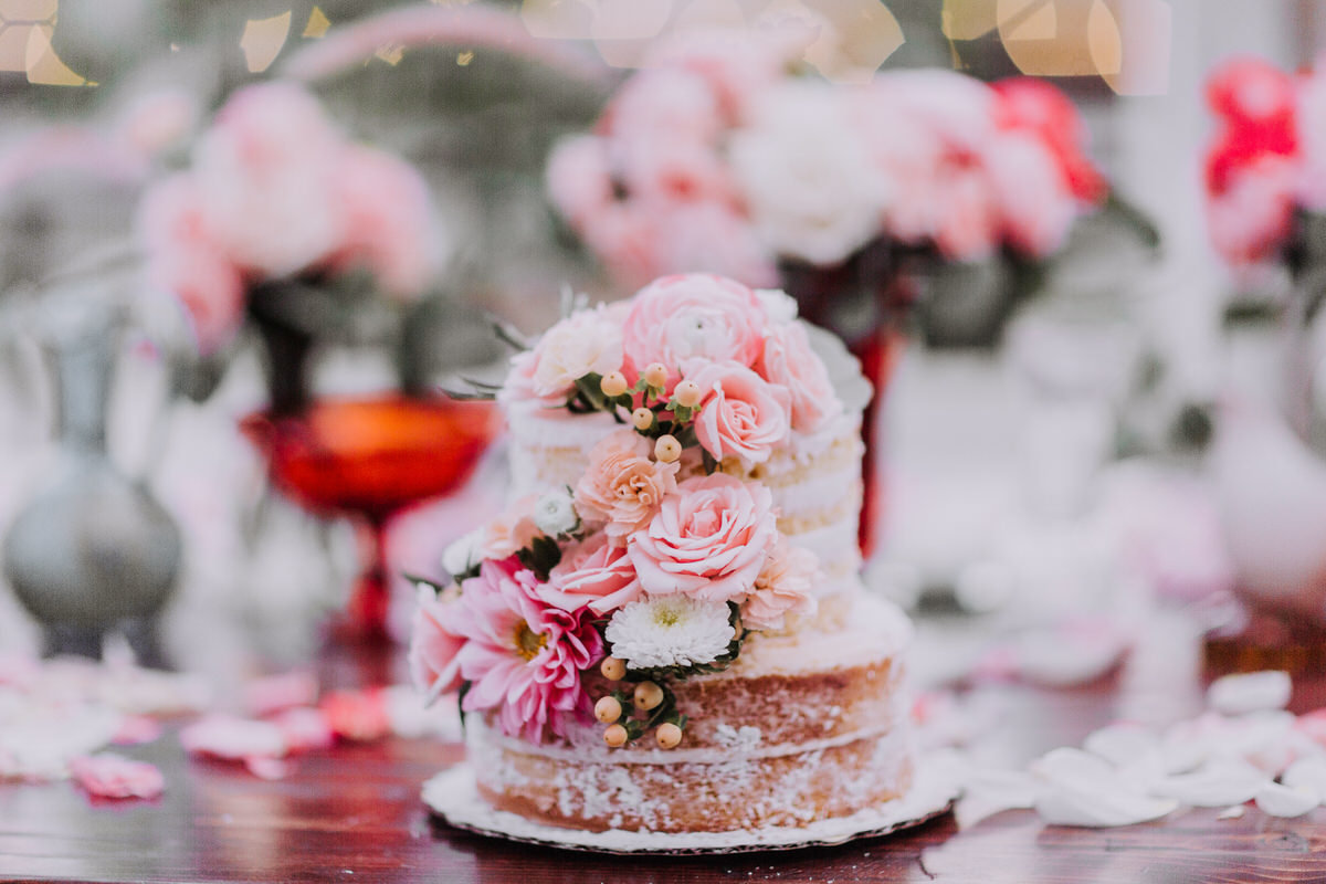 Lake Tahoe wedding photography cake and pastel florals on display at reception
