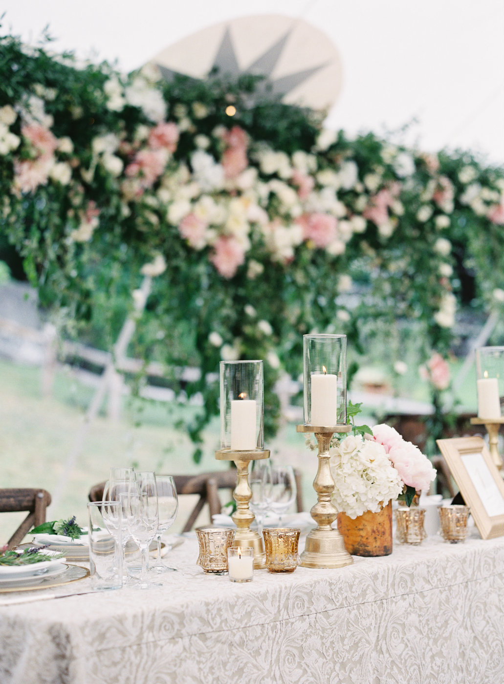 Gorgeous head table with gold accents and blush flowers designed by Flora Nova Design.