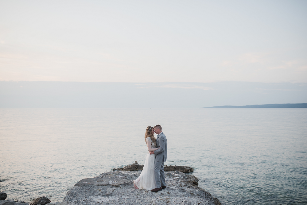 Bride and Groom in Front of Water Lake Michigan Wedding