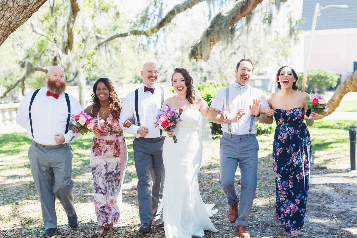Riverside Jacksonville Wedding Party Walking and Smiling