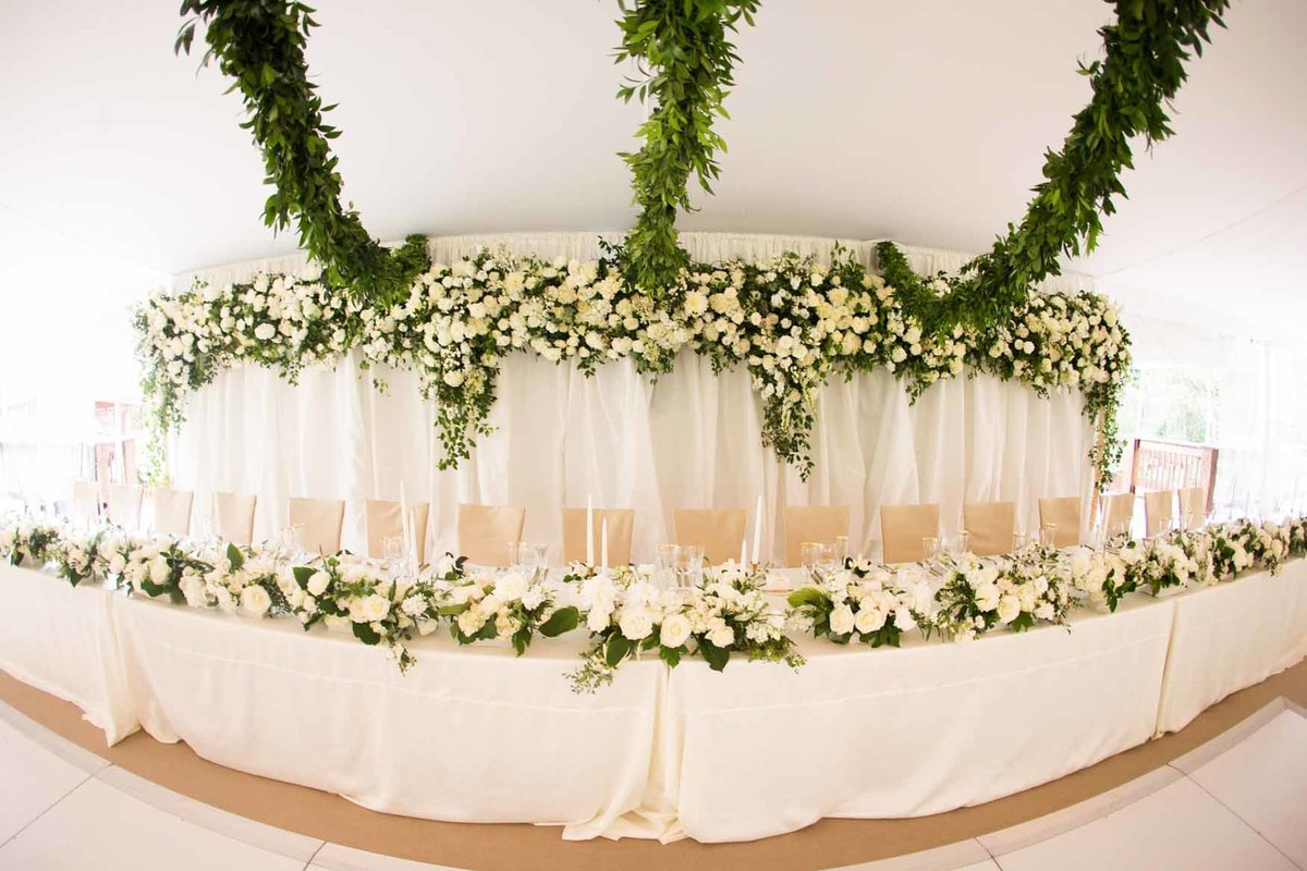 Large white floral instillation behind head table