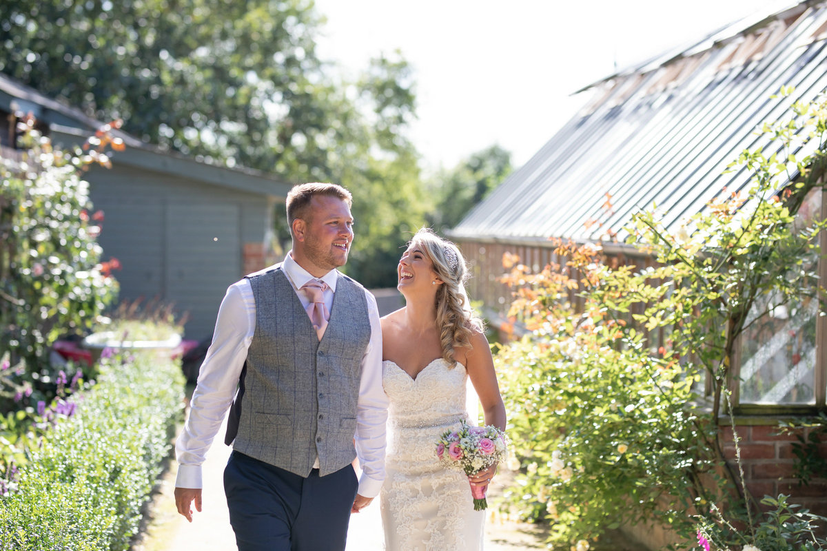 Bride and Groom in the veg garden at Deer Park Country House Hotel Wedding in Devon_