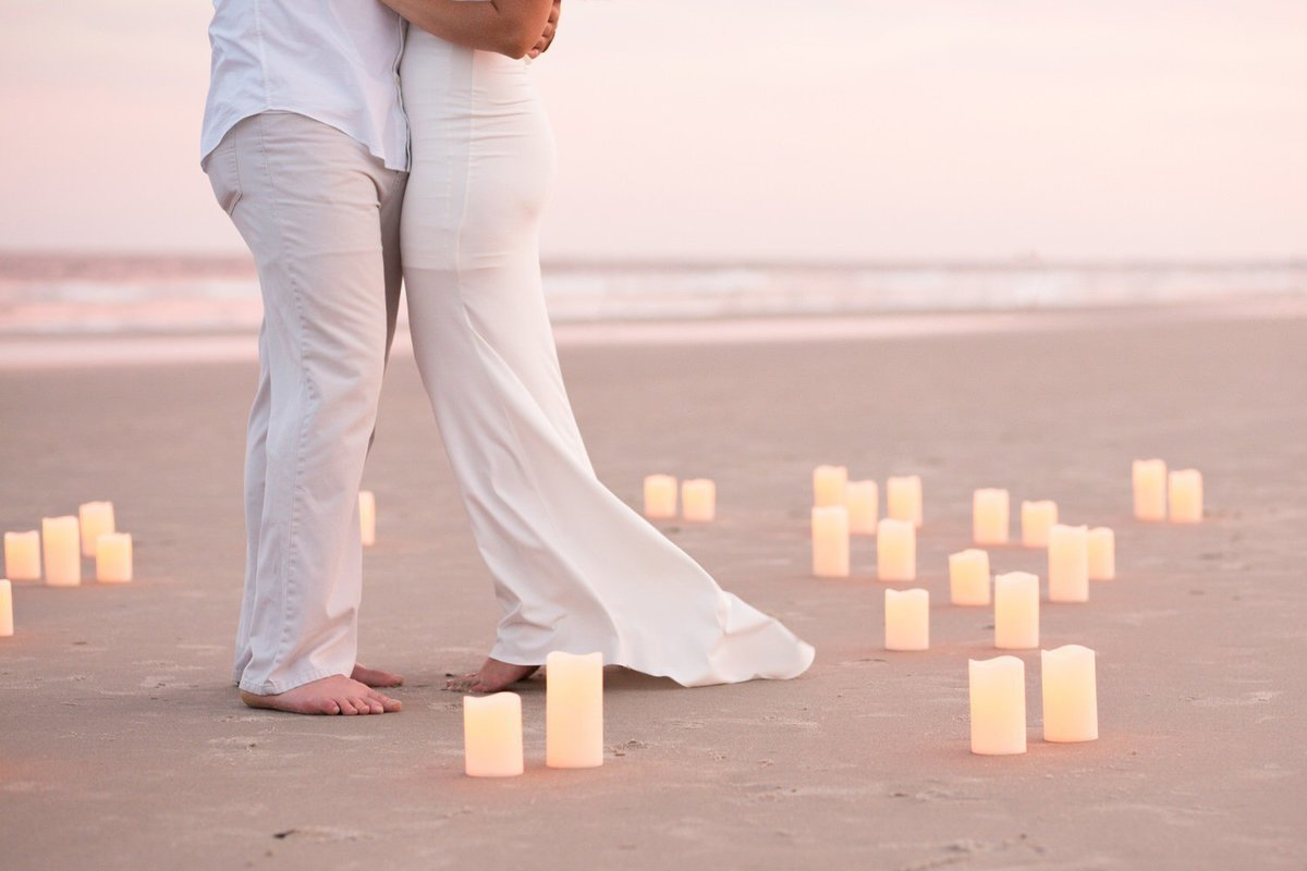 couple on beach with candles