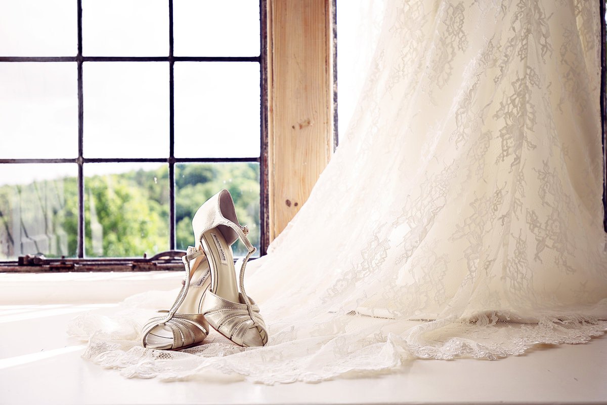 A Brides Shoes and Dress in the Bridal Suite at Askham Hall in the Lake District