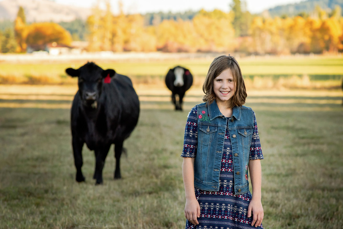 Portrait of young girl with cows in Cle Elum Washington