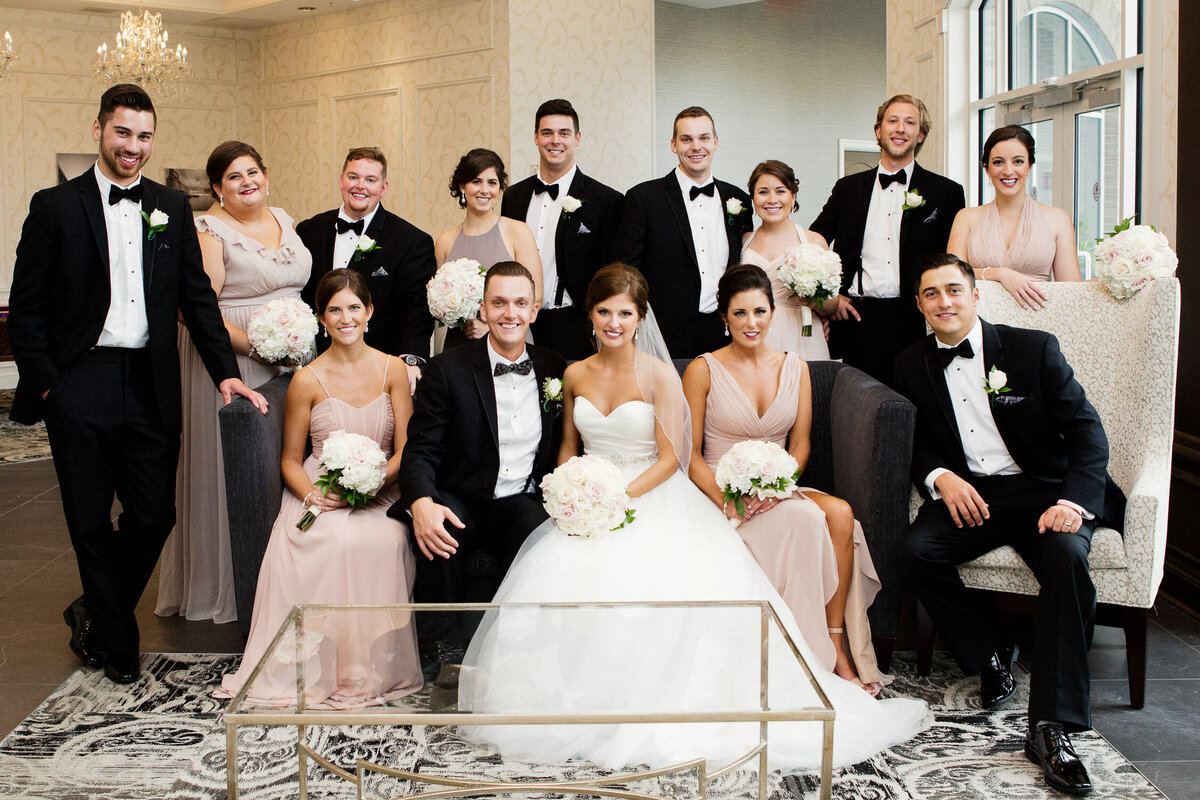 Bridal party sitting in reception room on wedding day in Buffalo, New York