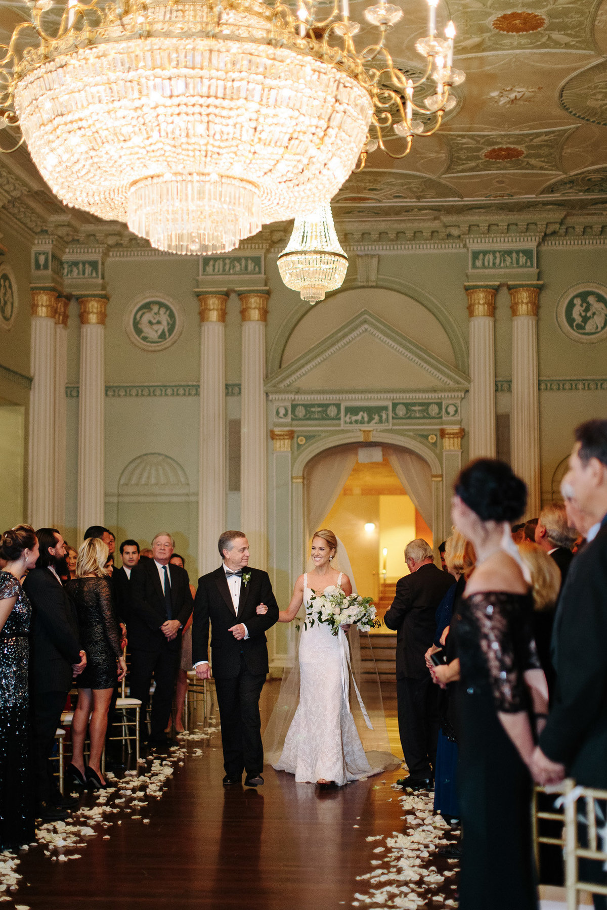 Rebecca Cerasani captures bride and father walking down the aisle in the Georgian Ballroom at the Biltmore Atlanta.