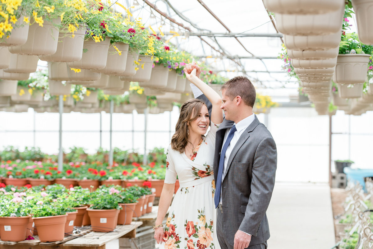 couple dancing in a garden for their anniversary session