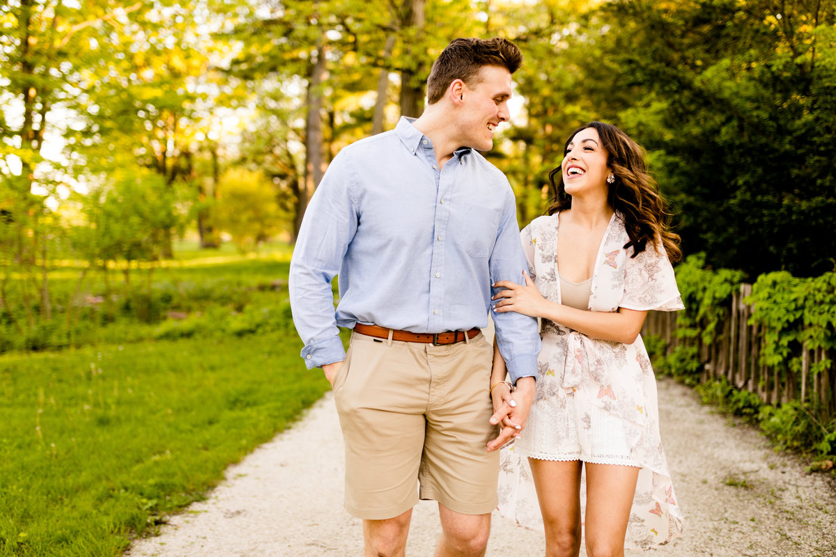 Engaged couple walking at fabyan forest preserve geneva il