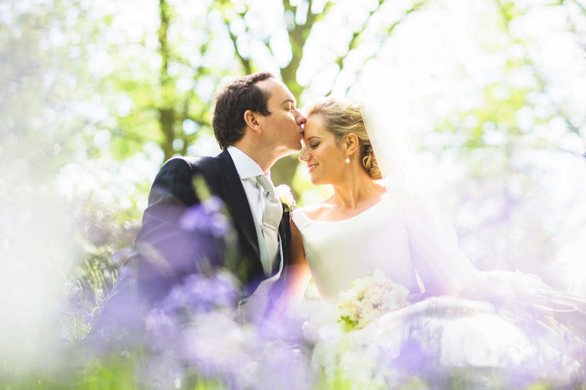 hedsor house wedding photography of bride and groom in bluebells