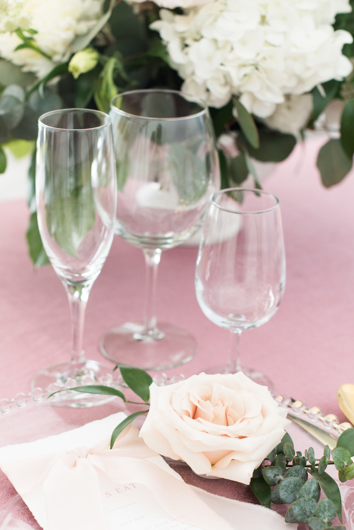 Glassware on velvet mauve table cloth from Tents & Events in Thunder Bay