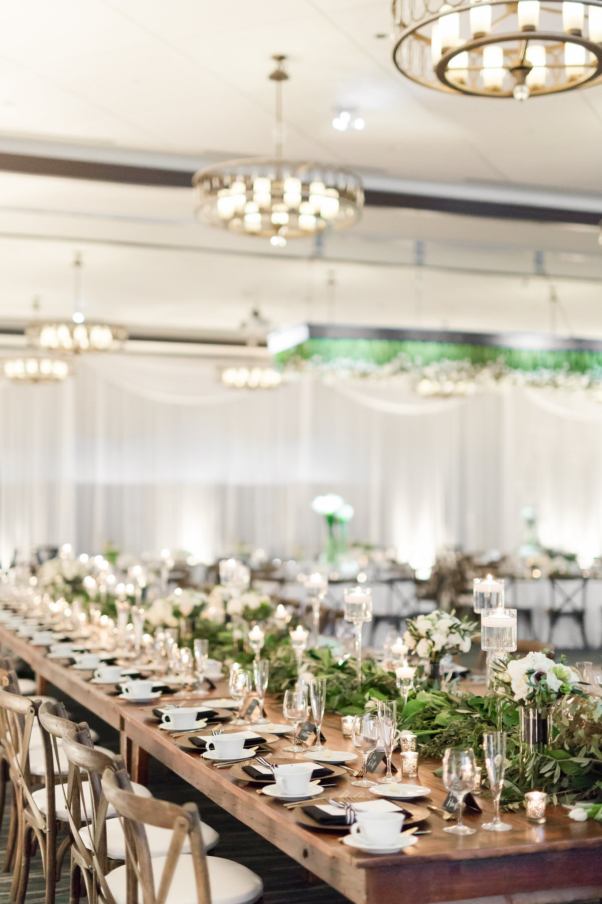white floral, wood harvest table, ballroom wedding