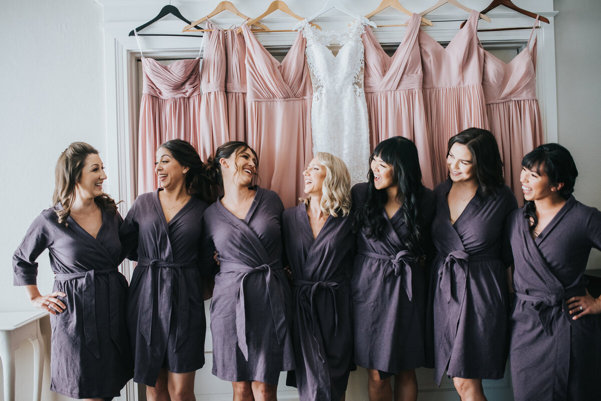 A bride shares a laughing moment with her bridesmaids in our getting ready suite.