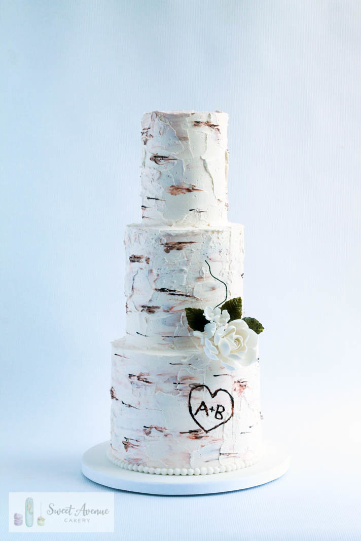 tree bark buttercream wedding cake with flowers
