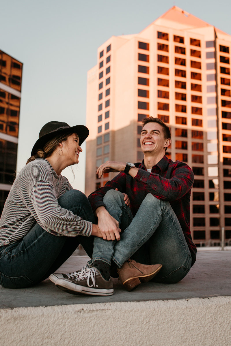 Couple sitting on a rooftop downtown Albuquerque
