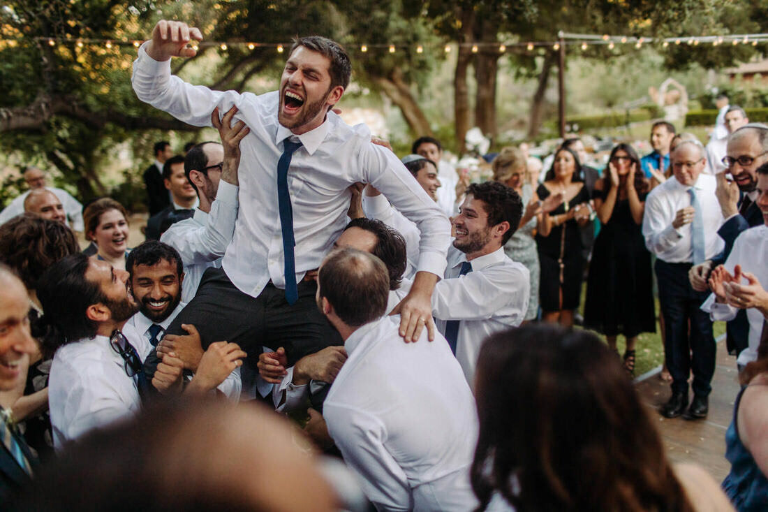 Jewish Groom dances on the dance floor at his malibu wedding reception.
