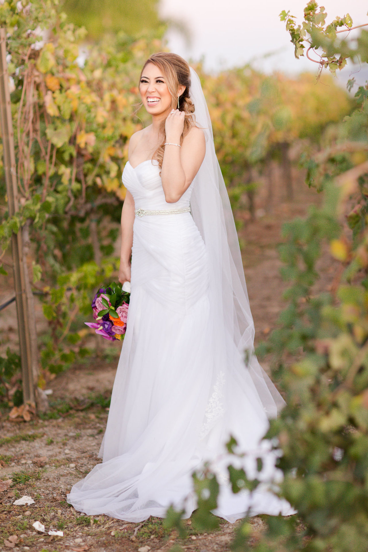 Stunning bride soaking up the sunset in the villa de amore vineyards by matty fran photography