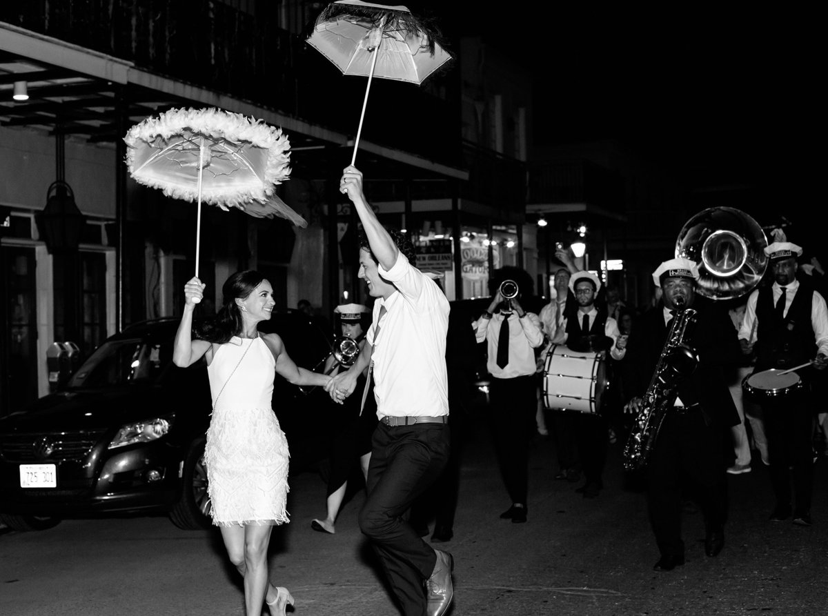 bride and groom celebrate during their second line destination wedding in New Orleans, Louisiana