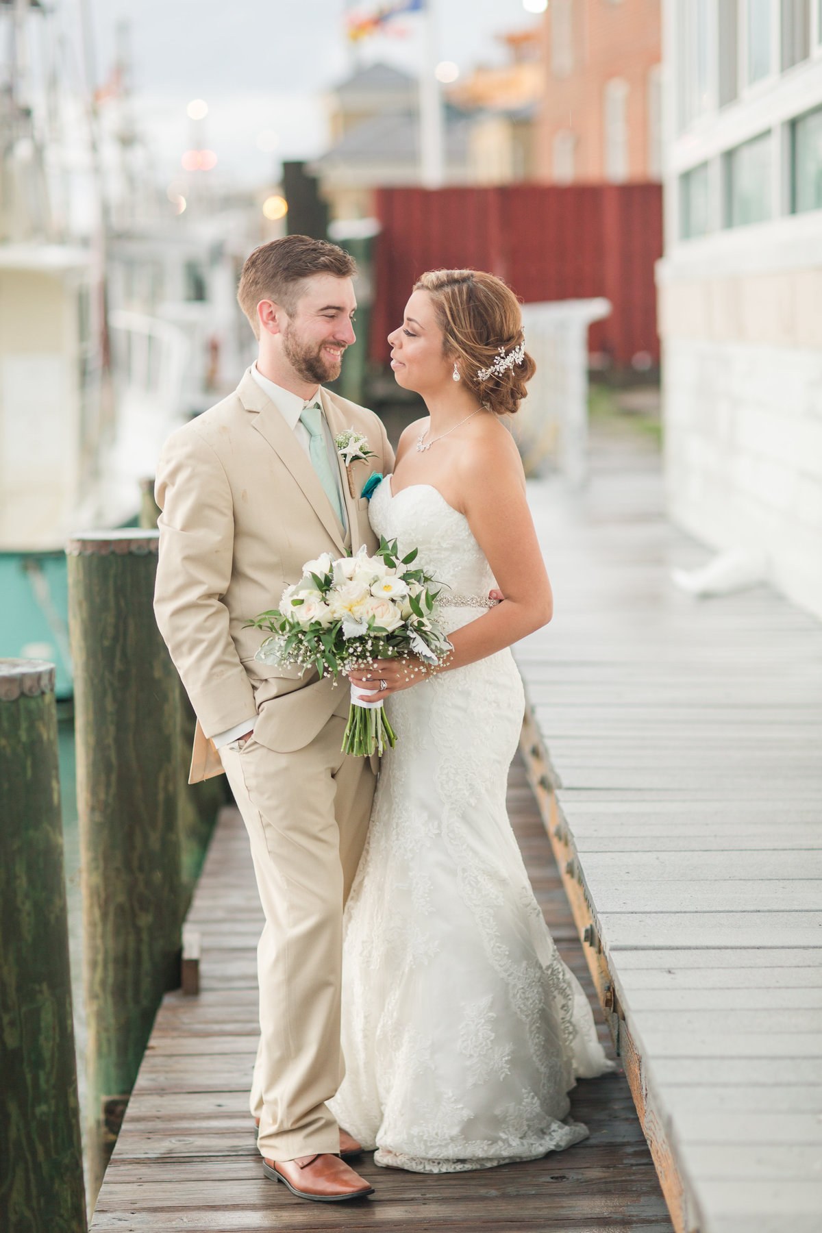 Bride and groom smiling on the dock at Lesner Inn