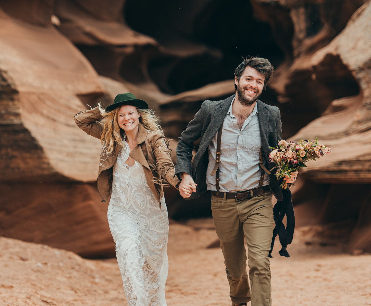 Adventure wedding couple runs through slot canyon in Arizona