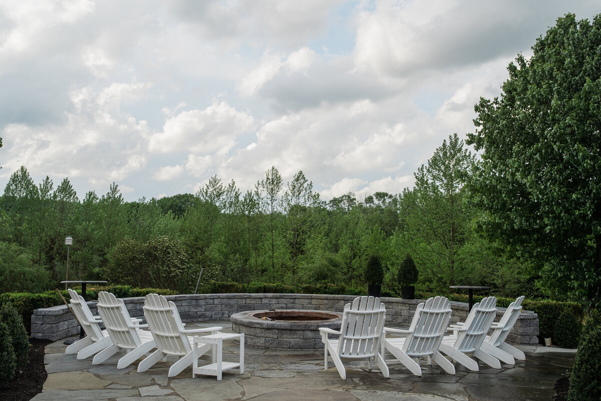 Beautiful view from farmhouse deck with firepit and Adirondack chairs
