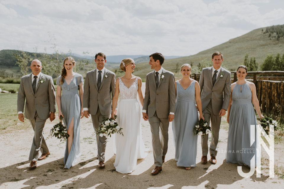 granby-colorado-strawberry-creek-ranch-classic-mountain-wedding-in-the-summer-bridal-party-walking-hand-in-hand