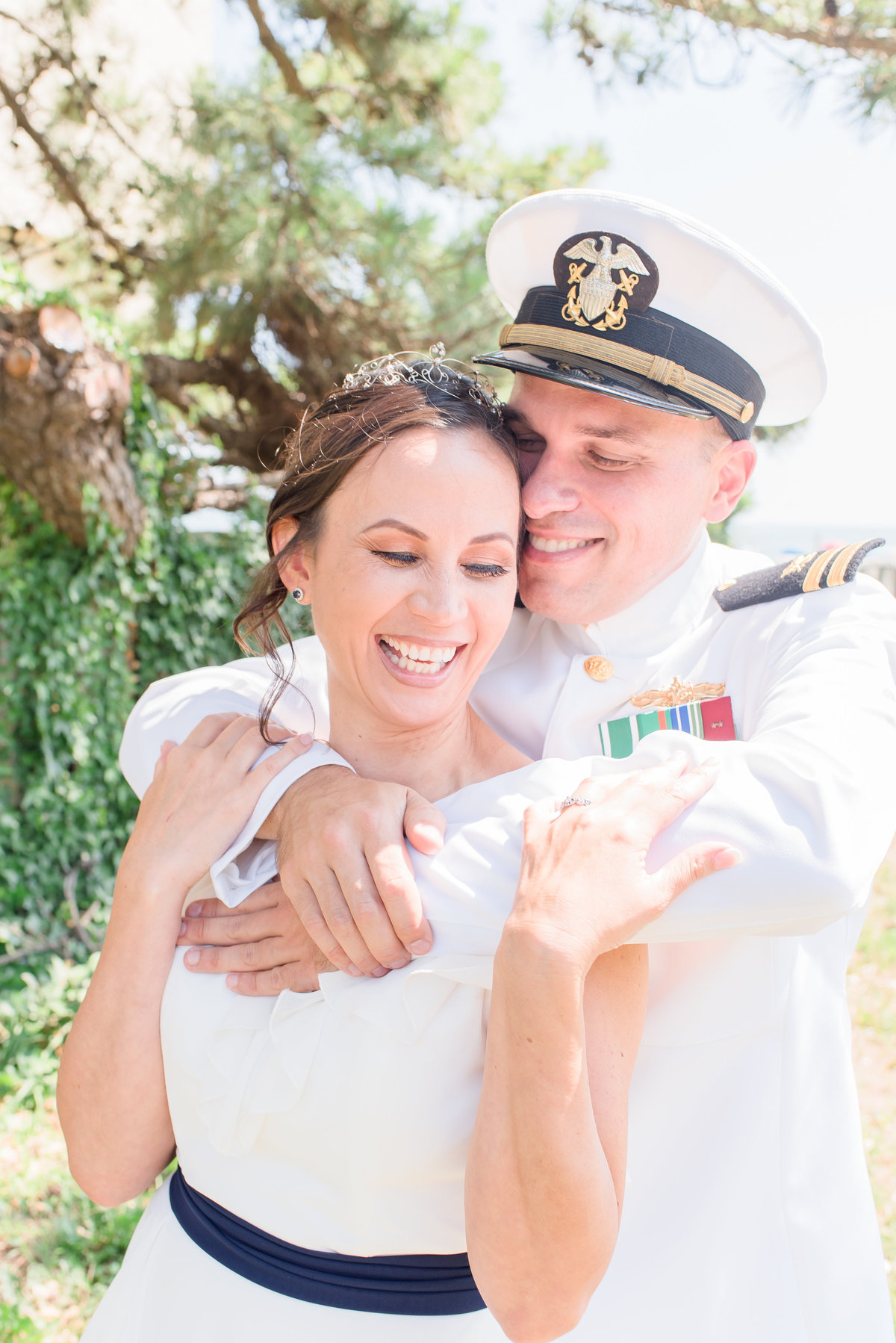 Virginia Wedding Photographer, groom in military uniform wrapping his arms around bride