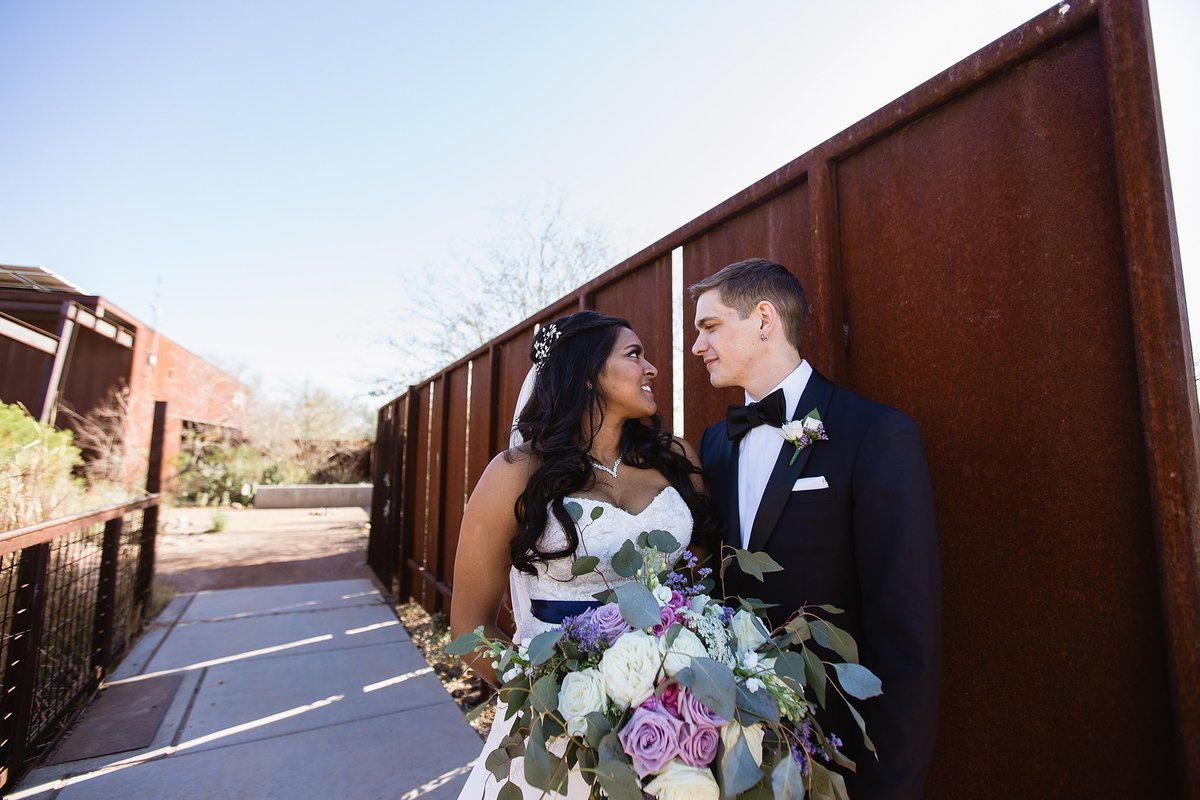 Couple looking at each other by Phoenix Wedding Photographers PMA Photography.