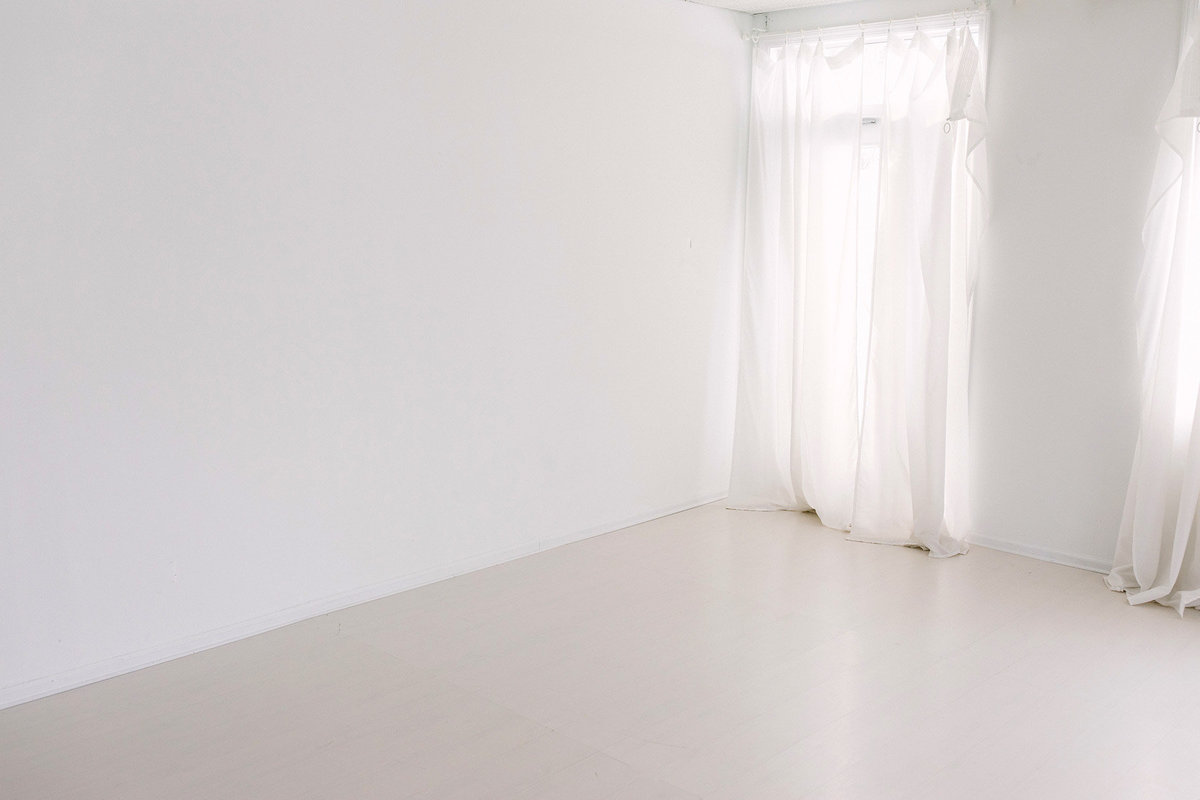 beautiful white floor and white walls in a studio by  Boudoir by Elle