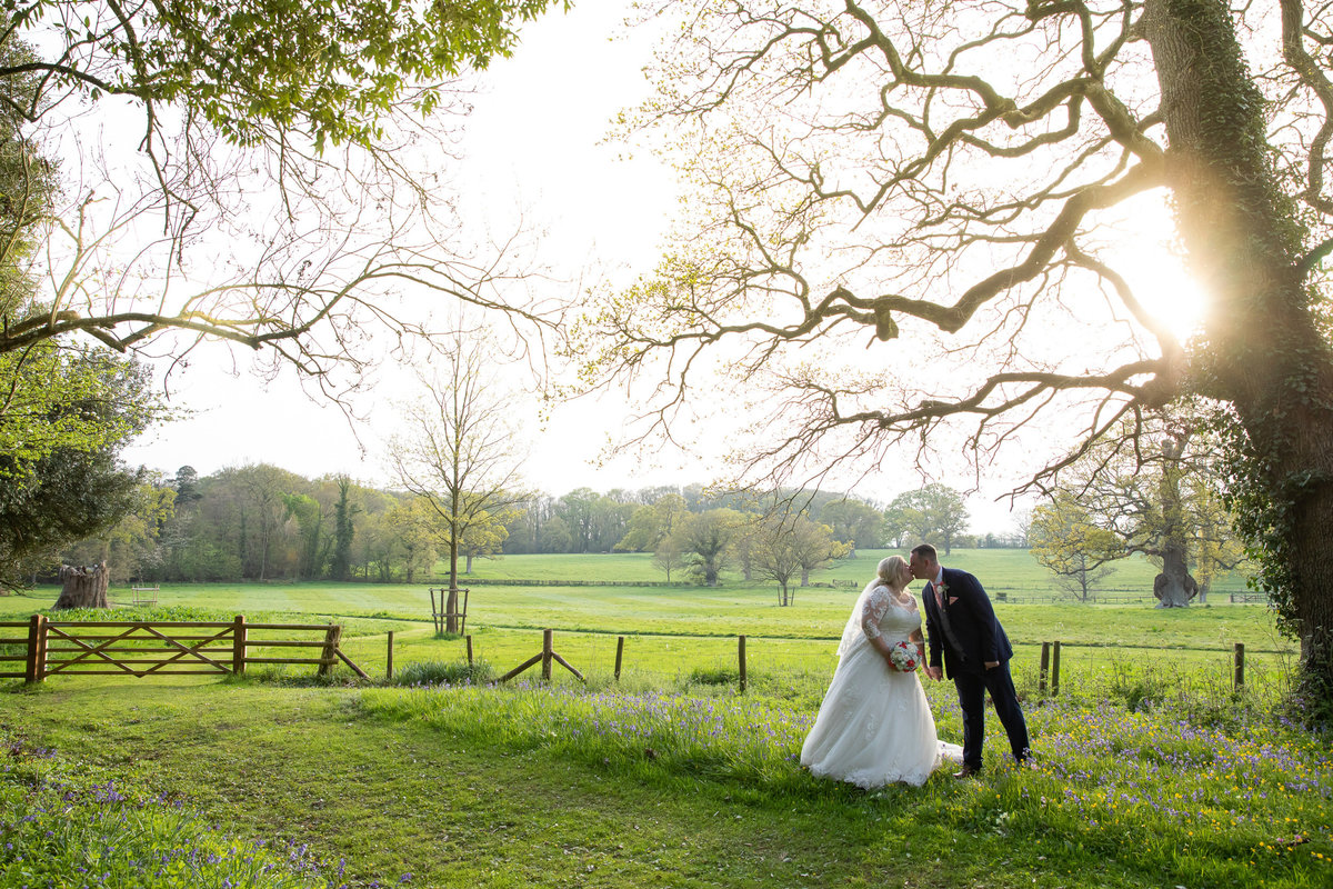Wedding photo of couple in grounds of Rockbeare Manor Exeter_