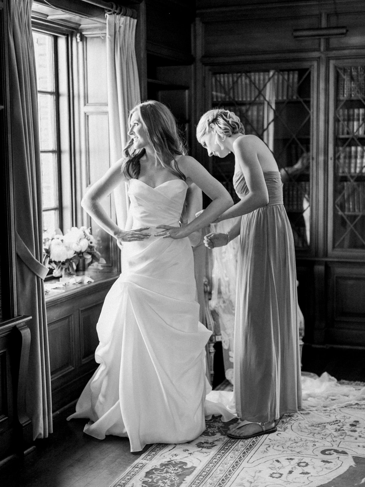 bride getting dressed on her wedding morning