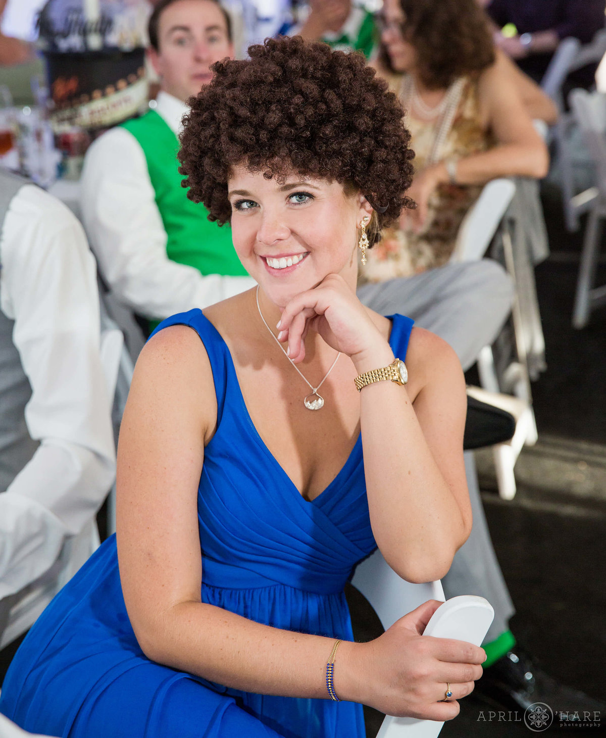 Bridesmaid wearing a silly wig at a Boulder Wedding Reception at Chautauqua Dining Hall
