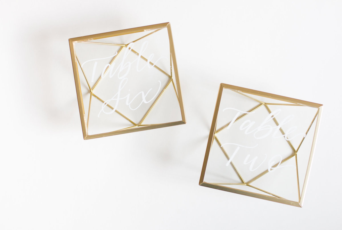 gold glass geometric table numbers for weddings or events rental through Hue + FA Rentals
