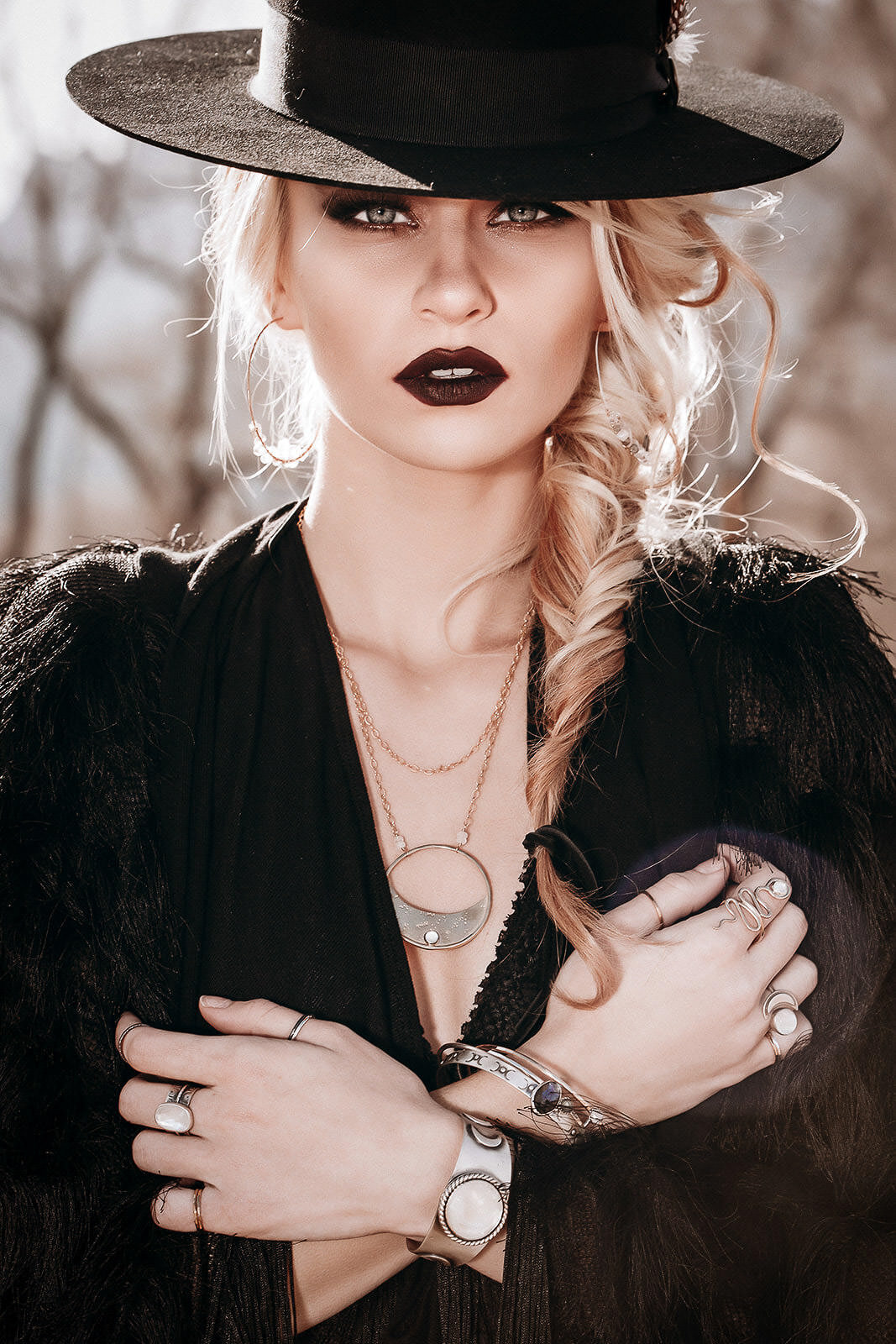 blonde girl with gothic jewelry_