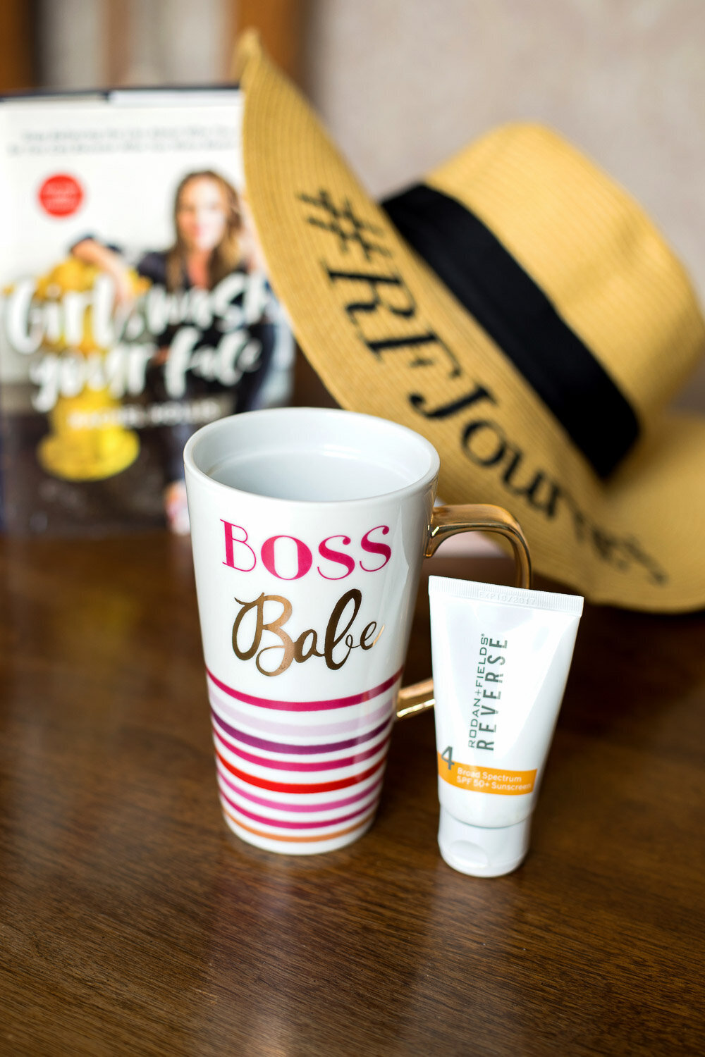 Boss babe mug with hat and book in the background