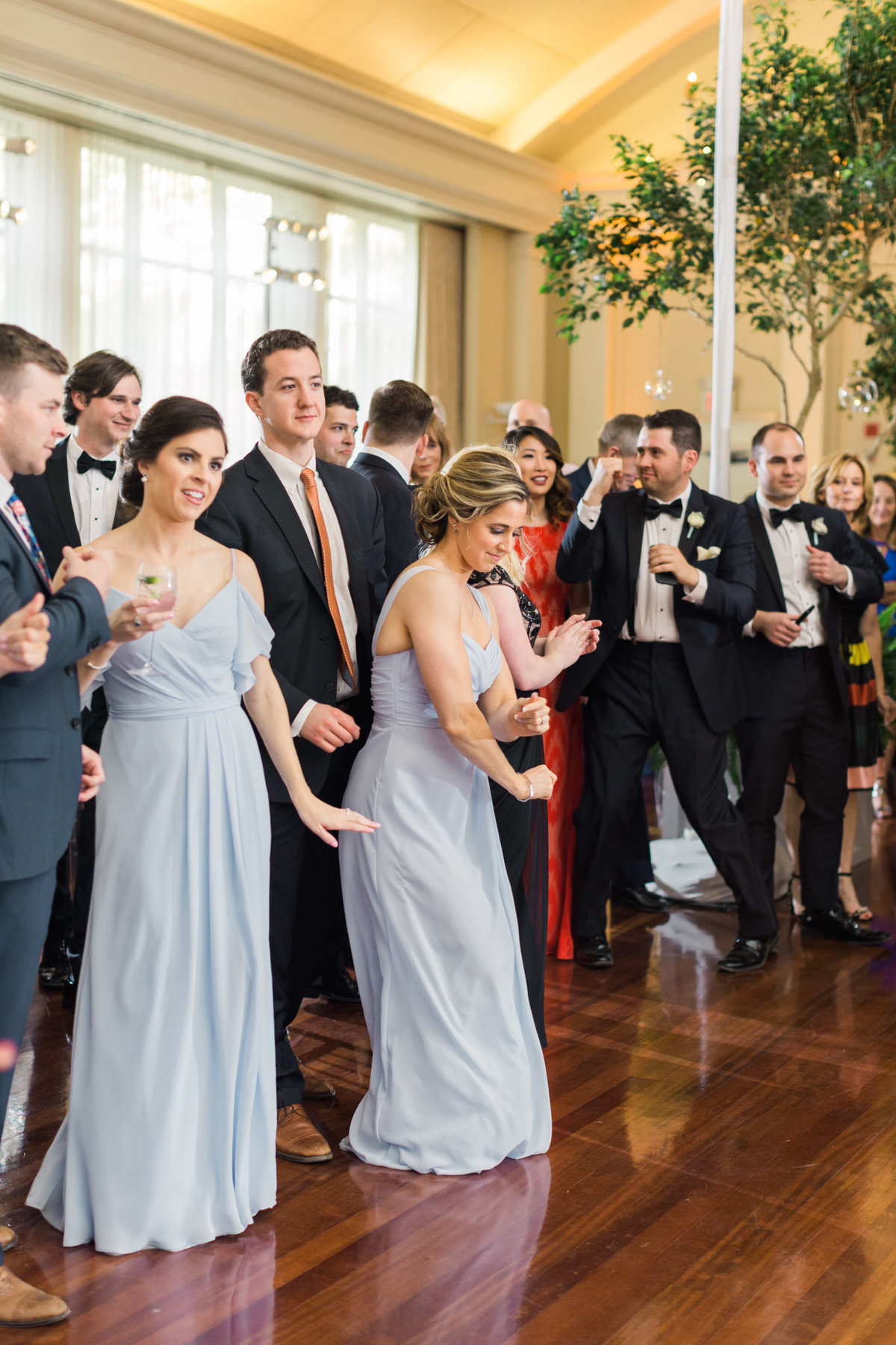The party starts off quickly as the bride and groom are announced for their first dance. Photo by luxury destination wedding photographer Rebecca Cerasani.